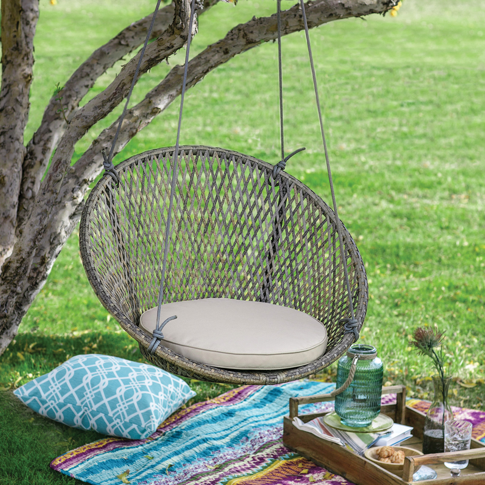 island bay saria resin wicker single hanging swing chair with seat pad hanging chairs   indoor  u0026 outdoor   hayneedle  rh   hayneedle
